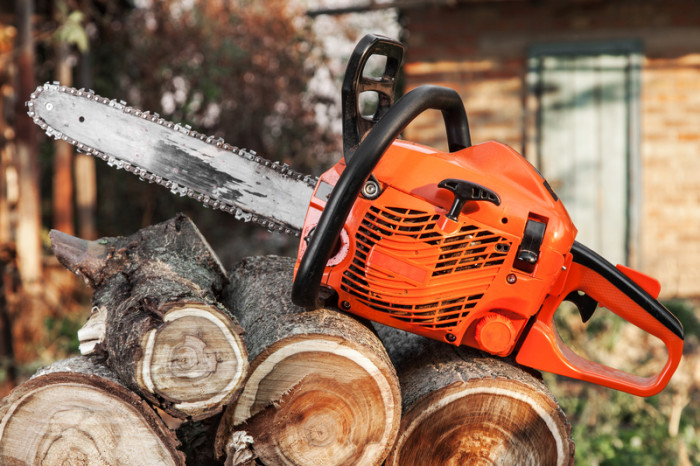 generic Husqvarna chainsaw on wood