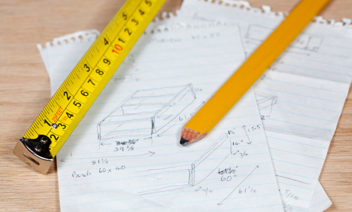 woodworking plan and pencil
